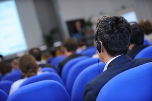 delegate listening to a simultaneous interpreter through headphones